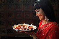 singapore traditional costume lady - Profile shot of Indian woman holding a tray of lit oil lamps Stock Photo - Premium Rights-Managednull, Code: 849-03645452