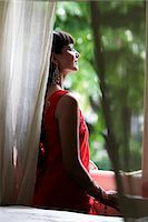 singapore traditional costume lady - Indian woman looking out window Stock Photo - Premium Rights-Managednull, Code: 849-03645472