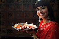 singapore traditional costume lady - Indian woman holding tray of lit oil lamps Stock Photo - Premium Rights-Managednull, Code: 849-03645480