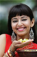 singapore traditional costume lady - Head shot of Indian woman smiling and holding flowers Stock Photo - Premium Rights-Managednull, Code: 849-03645636