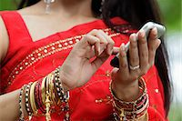 singapore traditional costume lady - Close up of Indian woman texting on phone Stock Photo - Premium Rights-Managednull, Code: 849-03645718
