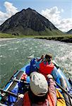 Two rafters rowing through a fast stretch of the Kongakut River on a sunny day with scenic mountains in the background, ANWR, Arctic Alaska, Summer Stock Photo - Premium Rights-Managed, Artist: AlaskaStock, Code: 854-03645865
