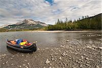 An inflatable canoe rests on the shore of the Alatna River during a backcountry trip in Gates of the Arctic National Park & Preserve, Arctic Alaska, Summer Stock Photo - Premium Rights-Managednull, Code: 854-03645867