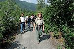 Female Forest Service guide leading hikers on a trail to Spencer Glacier as part of the Alaska Railroad's Spencer Whistle Stop Camping tour, Southcentral Alaska, Summer Stock Photo - Premium Rights-Managed, Artist: AlaskaStock, Code: 854-03645926