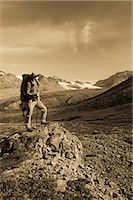 Male backpacker stops to view Gulkana Glacier while hiking in the Alaska Range, Southcentral Alaska, Summer/n Stock Photo - Premium Rights-Managednull, Code: 854-03645930