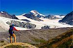 Male backpacker stops to view Gulkana Glacier while hiking in the Alaska Range, Southcentral Alaska, Summer/n Stock Photo - Premium Rights-Managed, Artist: AlaskaStock, Code: 854-03645935