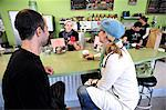 A couple visit over a cup of coffee at Snow City Cafe in Downtown Anchorage, Southcentral Alaska, Summer/n Stock Photo - Premium Rights-Managed, Artist: AlaskaStock, Code: 854-03646285