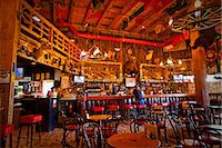 saloon - Tourist sits at the bar of the Red Dog Saloon in Juneau, Southeast Alaska, Summer Stock Photo - Premium Rights-Managednull, Code: 854-03646300