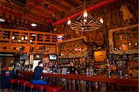 saloon - Tourist sits at the bar of the Red Dog Saloon in Juneau, Southeast Alaska, Summer Stock Photo - Premium Rights-Managednull, Code: 854-03646301