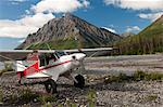 An Aviat Aircraft Husky A-1B rests on a gravel bar along the North Fork of the Koyukuk River with Frigid Crags looming in the background, Gates of the Arctic National Park & Preserve, Arctic Alaska, Summer Stock Photo - Premium Rights-Managed, Artist: AlaskaStock, Code: 854-03646429