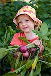 Toddler girl holds up a bunch of home grown radishes fresh out of the garden, Anchorage, Southcentral Alaska, Summer Stock Photo - Premium Rights-Managed, Artist: AlaskaStock, Code: 854-03646457