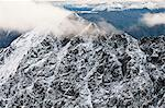 Aerial view of Boreal Mountain summit dusted with fresh snow in Gates of the Arctic National Park and Preserve, Arctic Alaska, Summer Stock Photo - Premium Rights-Managed, Artist: AlaskaStock, Code: 854-03646627