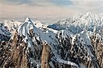 Aerial view of snow swept peaks and sheer granite walls in the Alaska Range in Denali National Park & Preserve, Interior Alaska, Summer Stock Photo - Premium Rights-Managed, Artist: AlaskaStock, Code: 854-03646645