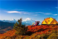 A couple view Mt.McKinley from their campsite in Peters Hills, Denali State Park, Southcentral Alaska, Fall/n Stock Photo - Premium Rights-Managednull, Code: 854-03646871