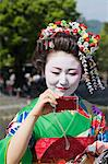 Maiko Taking Pictures, Arashiyama, Kyoto, Kyoto Prefecture, Kansai, Honshu, Japan Stock Photo - Premium Rights-Managed, Artist: Jeremy Woodhouse, Code: 700-03654476