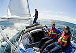 Men on sailboat Stock Photo - Premium Royalty-Free, Artist: Westend61, Code: 698-03656223
