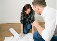 Two colleagues looking at blueprints on floor Stock Photo - Premium Royalty-Freenull, Code: 698-03656690