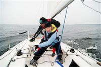 sports and sailing - Crew wrapping lines around crank Stock Photo - Premium Royalty-Freenull, Code: 698-03656758