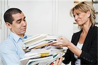 Two people carrying books Stock Photo - Premium Royalty-Freenull, Code: 698-03656887