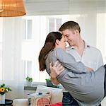 Man lifting woman Stock Photo - Premium Royalty-Free, Artist: Arcaid, Code: 698-03656919