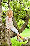 Girl sitting in tree Stock Photo - Premium Royalty-Free, Artist: Aflo Relax, Code: 698-03657888