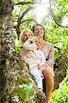 Mother and two daughters sitting tree Stock Photo - Premium Royalty-Free, Artist: Aflo Relax, Code: 698-03657889