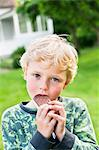 Boy eating ice cream outside Stock Photo - Premium Royalty-Free, Artist: Aflo Relax, Code: 698-03657907