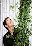 Happy man looking at his plant Stock Photo - Premium Royalty-Free, Artist: Aflo Relax, Code: 698-03658188