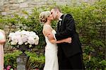Bride and Groom Kissing Stock Photo - Premium Royalty-Free, Artist: Ikonica, Code: 600-03659125