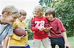 Boys Playing Football Stock Photo - Premium Rights-Managed, Artist: Kevin Dodge, Code: 700-03659102
