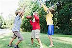 Boys Playing Football Stock Photo - Premium Rights-Managed, Artist: Kevin Dodge, Code: 700-03659104