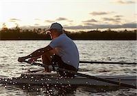 side view of person rowing in boat - Man Rowing, Toronto, Ontario, Canada Stock Photo - Premium Rights-Managednull, Code: 700-03659177
