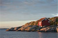 Red Wooden Hut on Rocky Coast, Bohuslaen, Sweden Stock Photo - Premium Rights-Managednull, Code: 700-03659272