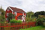 Red wooden house, Bullerbue, Smaland, Sweden Stock Photo - Premium Rights-Managed, Artist: Christina Krutz, Code: 700-03659289