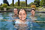 Portrait of a family in swimming pool Stock Photo - Premium Royalty-Freenull, Code: 621-03659349
