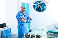 Surgeon in operating room Stock Photo - Premium Royalty-Freenull, Code: 644-03659491