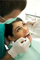 dentistry - Patient at the dentist Stock Photo - Premium Royalty-Freenull, Code: 644-03659552
