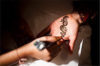 special moment - Bride Having Henna Applied to Hand Stock Photo - Premium Rights-Managednull, Code: 700-03665601