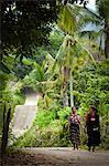 Two Women Walking on Road, Sumba, Indonesia