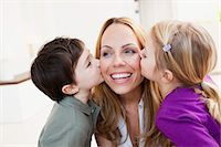 preteen kissing - brother and sister kissing her mother Stock Photo - Premium Royalty-Freenull, Code: 649-03666117