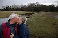Retired Couple Kissing Stock Photo - Premium Royalty-Freenull, Code: 649-03666671