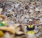 Worker With Paper In Recycle Plant Stock Photo - Premium Royalty-Free, Artist: Rolf Bruderer, Code: 649-03666901