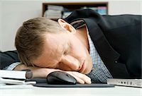 drunk passed out - Man is sleeping on desk Stock Photo - Premium Royalty-Freenull, Code: 698-03670015