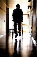 rehabilitation - Man with crutches in corridor Stock Photo - Premium Royalty-Freenull, Code: 698-03670195