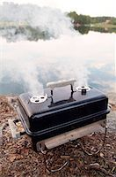 smoked - Smoke comming from grill Stock Photo - Premium Royalty-Freenull, Code: 698-03670271