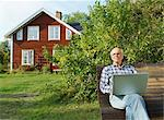 Elderly man sitting on bench with laptop Stock Photo - Premium Royalty-Free, Artist: Arcaid, Code: 698-03670887