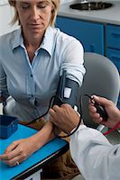 Doctor taking patient's blood pressure Stock Photo - Premium Royalty-Freenull, Code: 644-03672116