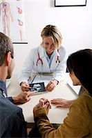 Doctor with ultrasound and couple Stock Photo - Premium Royalty-Freenull, Code: 644-03672145