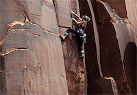 A rock climber tackles an overhanging crack in a sandstone wall on the cliffs of Indian Creek, a famous rock climbing area in Canyonlands National Park, near Moab, Utah, United States of America, North America Stock Photo - Premium Rights-Managednull, Code: 841-03675349