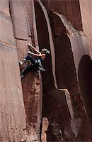 A rock climber tackles an overhanging crack in a sandstone wall on the cliffs of Indian Creek, a famous rock climbing area in Canyonlands National Park, near Moab, Utah, United States of America, North America Stock Photo - Premium Rights-Managednull, Code: 841-03675350